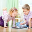 Brother and sister reading — Stock Photo