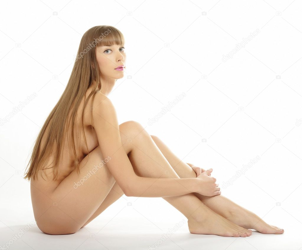 Young beautiful naked woman sitting on a floor, isolated on white background. — Stock Photo #4609272