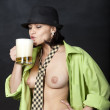 Topless woman in male shirt drinking beer — Стоковая фотография